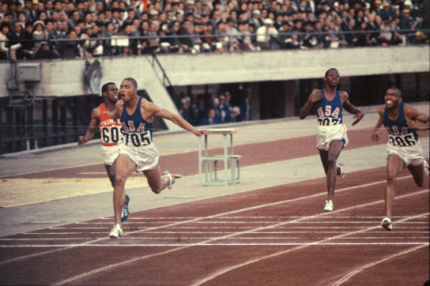 TOKYO, JAPAN - OCTOBER 17:  (CHINA OUT, SOUTH KOREA OUT) Henry Carr (2nd L) of United States crosses the finishing line to win the gold medal in the Men's 200m at the National Stadium during the Tokyo Olympic on October 17, 1964 in Tokyo, Japan.  (Photo by The Asahi Shimbun via Getty Images)
