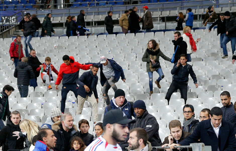Fans remained inside the Stade de France after the soccer game between France and Germany amid confusion caused by the attacks in the area. Credit Christophe Ena/Associated Press