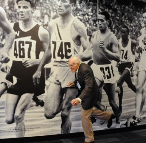 Zamperini in front of photo of Berlin Games
