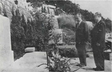 at grave of S. S. Kwan