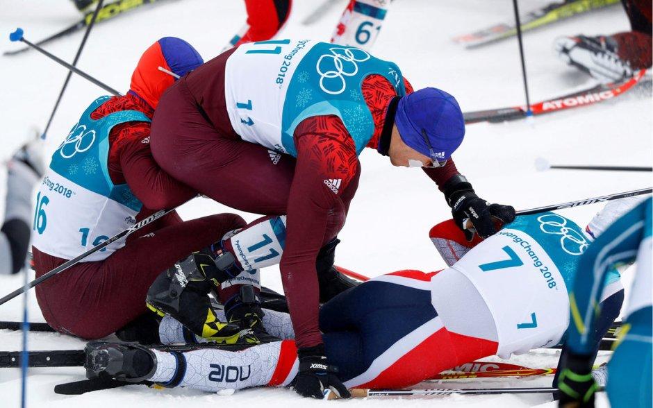 Simen Hegstad Krueger below two OAR skiers