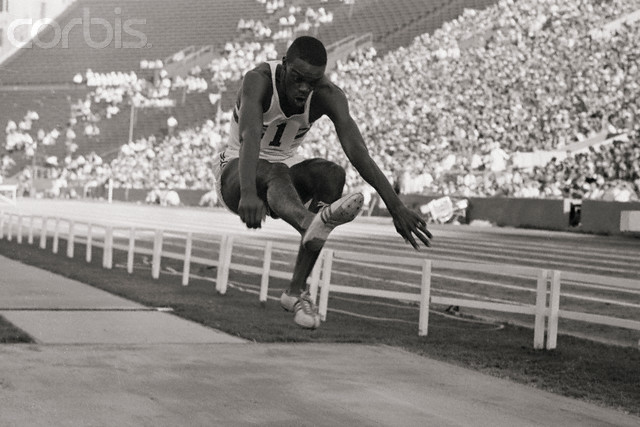 Ralph Boston Performing Record Breaking Jump at Olympics